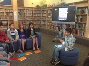 A Grade 2 student describes the Pottery App to his classmates.